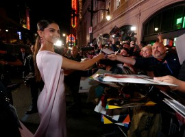 Cast member Deepika Padukone signs autographs at the premiere of
