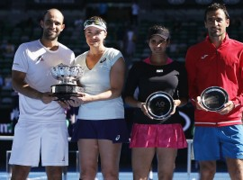 Abigail Spears of the U.S. and Colombia's Juan Sebastian Cabal pose with their trophy after winning their Mixed doubles final match against India's Sania Mirza and Croatia's Ivan Dodig.
