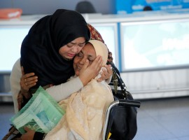 A woman greets her mother after she arrived from Dubai on Emirates Flight 203 at John F. Kennedy International Airport in Queens, New York, January 28, 2017.