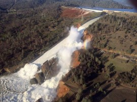 A damaged spillway with eroded hillside is seen in an aerial photo taken over the Oroville Dam in Oroville, California.