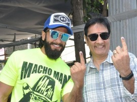 Bollywood actor Ranveer Singh casts his vote with his father at the ongoing civic body election in Bandra .