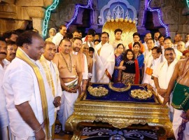 Almost the entire Telangana government on Tuesday descended on this temple town in Andhra Pradesh as Chief Minister K. Chandrasekhar Rao is all set to offer ornaments worth Rs 5.45 crore to Lord Balaji temple on Wednesday.