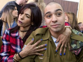 Israeli soldier Elor Azaria is embraced by his mother at the start of is sentencing hearing at a military court in Tel Aviv, Israel February 21, 2017.