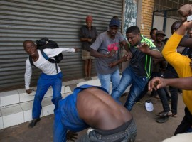 A vigilante mob attacks a Nigerian migrant outside a church in Pretoria, South Africa February 18, 2017.