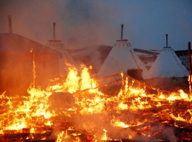 A building burns after it was set alight by protesters preparing to evacuate the main opposition camp against the Dakota Access oil pipeline near Cannon Ball, North Dakota.