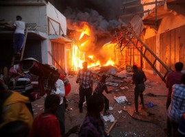 Somali traders attempt to salvage some of their wares from the burning stalls at the main Bakara market in Somalia's capital Mogadishu.