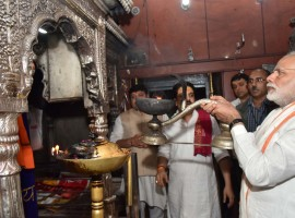 Prime Minister Narendra Modi on Saturday offered several litres of milk, Ganga jal and flowers at the fabled Kashi Vishwanath temple here and performed aarti at the sanctum sanctorum during a break in his road show. Amid tight security, the Prime Minister reached the temple at around 1:30 p.m. and paid obeisance to Lord Shiva, the presiding deity of Varanasi. Prayers were conducted by five priests headed by Acharya Ashok Dwivedi, a source informed IANS.