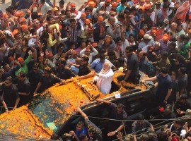 Prime Minister Narendra Modi arrived in the temple town of Varanasi on Saturday for his road show amid huge enthusiasm from his supporters here in his parliamentary constituency.