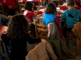 Children have bean soup for lunch at the Model National Nursery of Kallithea. Dozens of other children, all aged two to five, come in daily, but the days away from their parents are long.