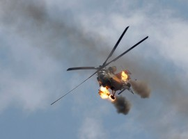 An Iraqi Air Force helicopter fires missiles against Islamic State militants during a battle in Mosul.