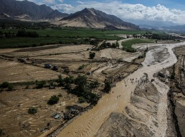 Aerial view from a helicopter as Peru's President Pedro Pablo Kuczynski observes the massive landslide and flood in Trujillo, northern Peru, March 21, 2017.