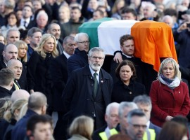 Sinn Fein President Gerry Adams (C) walks next to the coffin of Martin McGuinness during his funeral in Londonderry, Northern Ireland.