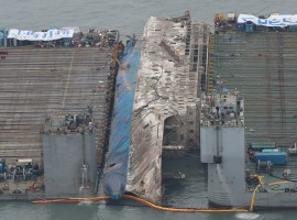 The sunken ferry Sewol is moved toward semi-submersible ship (not pictured) during its salvage operations at the sea off Jindo, South Korea, March 24, 2017.