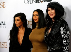 Singer Cher (R) poses with television personalities Kim Kardashian (C) and Kourtney Kardashian at the premiere of