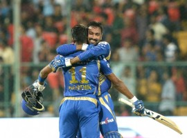 Kieran Pollards 70 runs in 47 deliveries helped Mumbai Indians withstand a fiery spell, including a hat-trick, from leg-spinner Samuel Badree as the visitors registered a four-wicket win over Royal Challengers Bangalore (RCB) to go top of the Indian Premier League (IPL) with six points here on Friday. In pursuit of RCB's 142/5, Mumbai had a horrendous start as Badree snared a hat-trick in the third over, removing Parthiv Patel (3), Mitchell McClanaghan (0) and Rohit Sharma (0) to plunge the visitors to 7/4, with opener Jos Buttler (2) already being dismissed by Stuart Binny in the second over. In the second ball of the West Indian leg-spinner Badree's second over, Parthiv offered a catch to Chris Gayle at short cover, while McClenaghan smashed a full toss into the hands of Mandeep Singh at long on. Facing the hat-trick ball, Mumbai captain Rohit Sharma couldn't tackle a googly which destroyed the stumps to mark Badree registering the 15th hat-trick in IPL history.