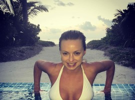 Ola Jordan shows cleavage in white bikini.