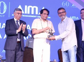 Filmmaker and Screenwriter Nitesh Tiwari receives Director of the Year award from Union Railway Minister Suresh Prabhu at the AIMA Awards ceremony in New Delhi, on April 27, 2017.