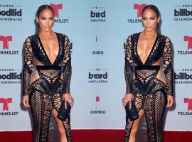 Jennifer Lopez bares all in a see-through crochet dress at the Billboard Latin Music Awards.