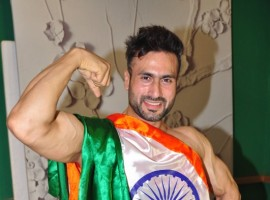 India Men's Physique 2017 Winner Rehaan Raas Dev of Jammu & Kashmir poses at a press conference in Mumbai on May 12, 2017. Rehaan Raas Dev is set to represent India in Mongolia later this month for the Mr Asia 2017 pageant.