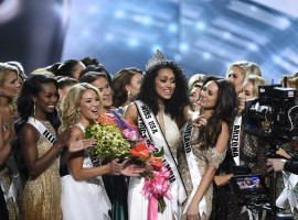A 25-year-old scientist representing the District of Columbia is crowned winner of the Miss USA pageant.