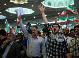 Supporters of Iranian presidential candidate Ebrahim Raisi chant slogans during a campaign meeting at the Mosalla mosque in Tehran, Iran, May 16, 2017. Under Iran's system, the powers of the elected president are circumscribed by those of the conservative supreme leader, Ayatollah Ali Khamenei, who has been in power since 1989. All candidates must be vetted by a hardline body. Nevertheless, elections are fiercely contested and can bring about change within the system of rule overseen by Shi'ite Muslim clerics.
