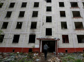 A worker passes a building, which is part of the old five-storey apartment blocks demolition project launched by the city authorities, in Moscow, Russia. The Moscow government plans to resettle millions of citizens from shoddy Soviet-era apartment blocks. The draft law on renovation envisages moving some Muscovites into modern flats but has also fuelled concerns about property rights, a year after city authorities provoked an outcry among small businesses by bulldozing many street kiosks.