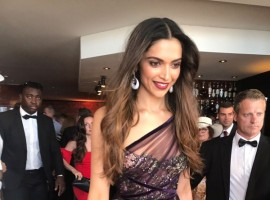 Bollywood actress Deepika Padukone let her hair loose - literally - as she stepped out in a jewel-toned maroon creation by Marchesa Notte for her red carpet appearance at the opening ceremony of the Cannes Film Festival here on Wednesday. She walked before the screening of French director Arnaud Desplechin's