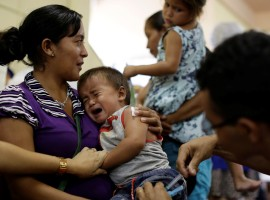 A nurse gives a flu vaccine to a baby from the indigenous Warao people from the Orinoco Delta in eastern Venezuela, in Manaus, Brazil.