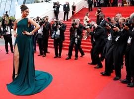 Indian actress Deepika Padukone's second red carpet appearance at the Cannes Film Festival here saw her make a bold statement with smoky eyes in antique green, matched with a bottle green gown which had a thigh-high slit to add the oomph.