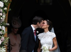 Pippa Middleton kisses her new husband James Matthews, following their wedding ceremony at St Mark's Church in Englefield, west of London.