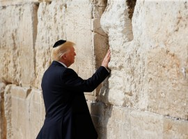 U.S. President Donald Trump touches the Western Wall, Judaism's holiest prayer site, in Jerusalem's Old City May 22, 2017.