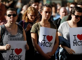 Women wait to take part in a vigil for the victims of an attack on concert goers at Manchester Arena, in central Manchester, Britain May 23, 2017.