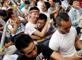 Supporters hug each other during a rally after Taiwan's constitutional court ruled that same-sex couples have the right to legally marry, the first such ruling in Asia, in Taipei, Taiwan May 24, 2017.