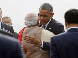 U.S. President Barack Obama hugs India's Prime Minister Narendra Modi as he arrives at Air Force Station Palam in New Delhi January 25, 2015.
