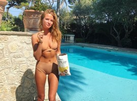 Millie Mackintosh flaunts her toned abs and enviable physique in a tiny bikini.