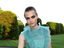 English fashion model and actress Cara Jocelyn Delevingne flaunts her tattoo at Save the Elephants event.