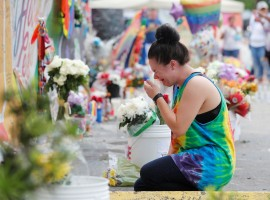 Chelsea Nylen reacts while visiting the memorial outside the Pulse Nightclub on the one-year anniversary of the shooting in Orlando, Florida.