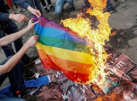 Anti-LGBT protesters burn an LGBT flag during the opening ceremony of Kiev Pride 2017 in Kiev, Ukraine, June 13, 2017.