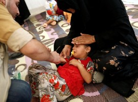 A displaced Iraqi girl is treated in a field hospital at the Hasansham U2 camp, where more than 300 people fell ill in a mass outbreak of food poisoning, in al-Khazer, east of Mosul, Iraq June 13, 2017.