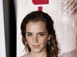 Emma Watson shows her sensational figure in a beautiful plunging white gown.