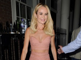 Amanda Holden flashes ample cleavage and toned midriff in sexy crochet two-piece.