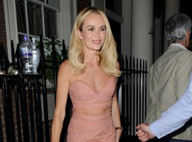 Britain Got Talent's Amanda Holden flashes ample cleavage and toned midriff in sexy crochet two-piece.