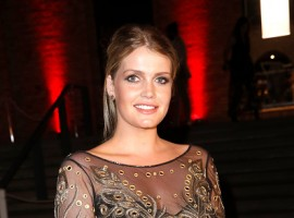Charles Spencer's daughter Lady Kitty Spencer dazzles in racy sheer gown at Raffaello Summer party.