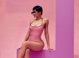 Model Kylie Jenner shows her eye-popping cleavage as she promotes her new range of sunglasses.