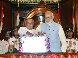 A minute after the stroke of midnight, President Pranab Mukherjee and Prime Minister Narendra Modi pressed the button to launch the new indirect tax regime on a digital screen with