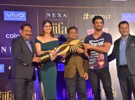 Actors Kriti Sanon and Sushant Singh Rajput with composer AR Rahman during a press conference regarding International Indian Film Academy (IIFA) Awards; in New Delhi on July 4, 2017.