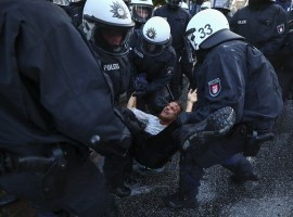 German riot police detain a protester during clashes with anti-G20 protesters.