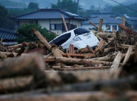 A damaged car is seen at an area hit by heavy rain in Asakura, Fukuoka Prefecture, Japan.