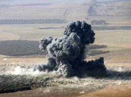 Smoke rises at Islamic State militants' positions in the town of Naweran, near Mosul.