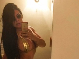 Former Miss Bum Bum Suzy Cortez flaunts her curves in world's smallest bikini.